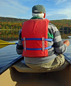 Canoer paddling in the fall